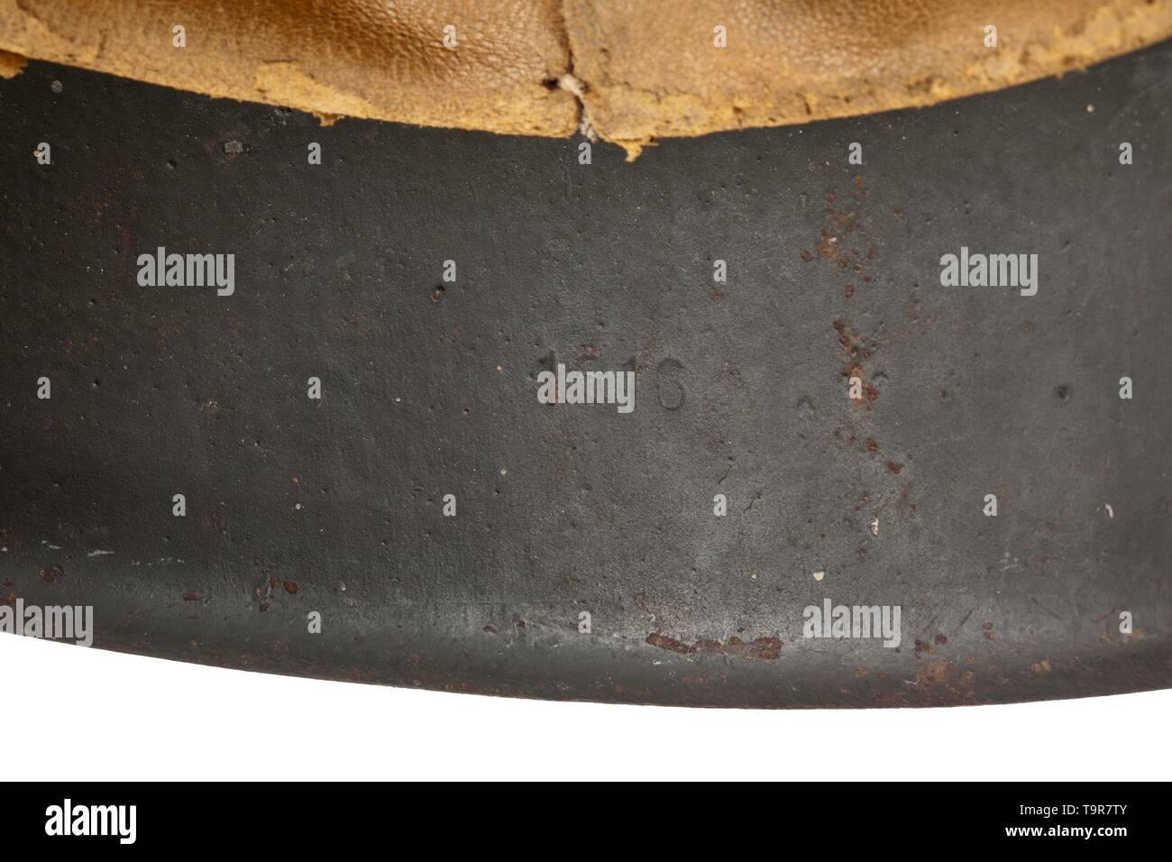 """A steel helmet M 40 for French foreign legion volunteers personal piece of """"Chef Lacomnie"""" Field-grey painted steel skull, the National emblem nearly intact, the French national shield contemporarily applied by hand, the interior with maker stamps """"ET66"""" and """"1616"""", acceptance stamp in the crest, complete inner liner with chinstrap and handwritten wearer's designation. An old inventory tag """"Collection Andre Thelot"""" is attached with designation of origin. historic, historical, army, armies, armed forces, military, militaria, object, objects, stills, clipping, clippings, cut , Editorial-Use-Only Stock Photo"""