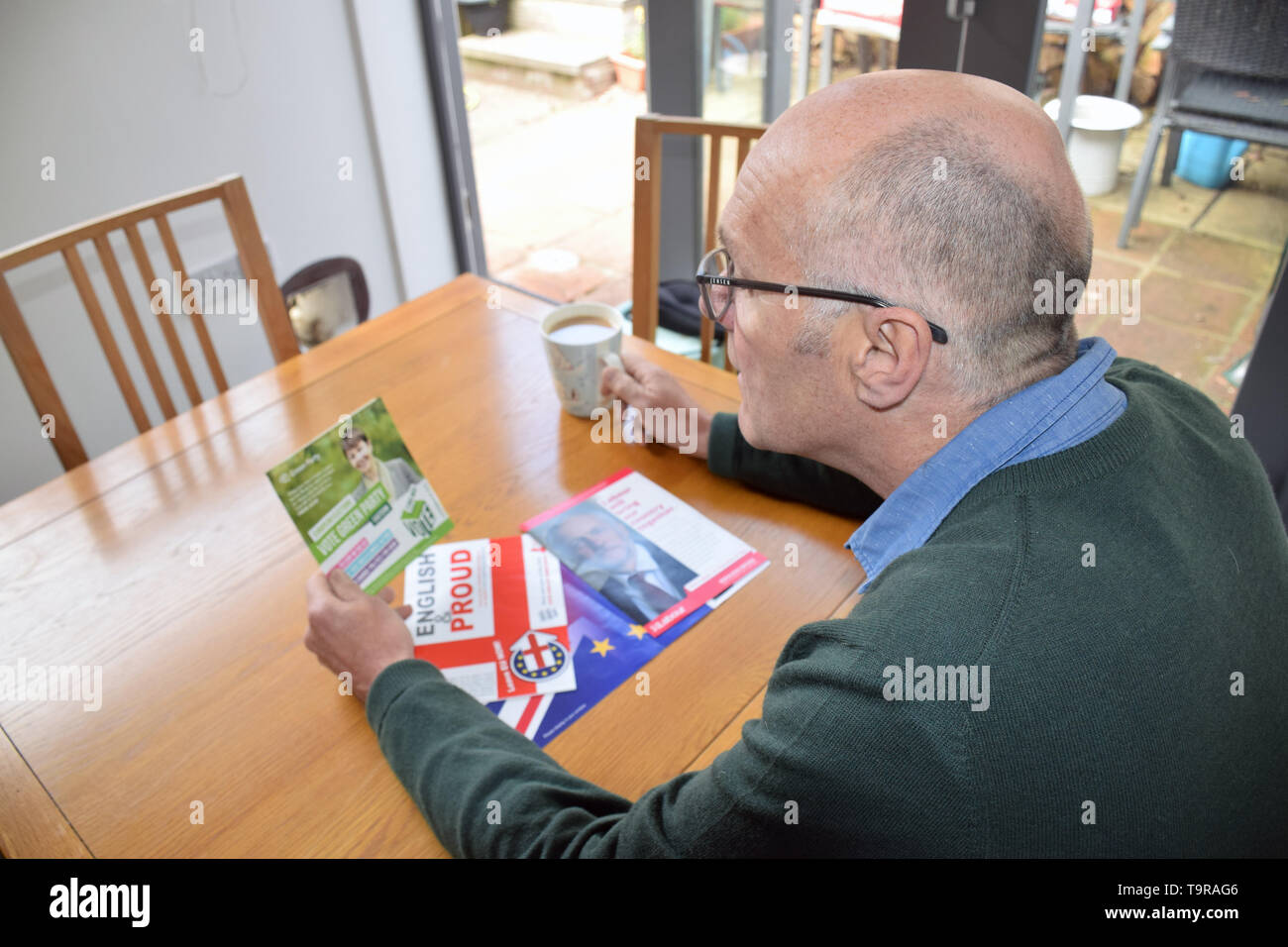 European Parliament Elections May 2019 - man reading various Green Party political party leaflet. UK May 2019 - Stock Image