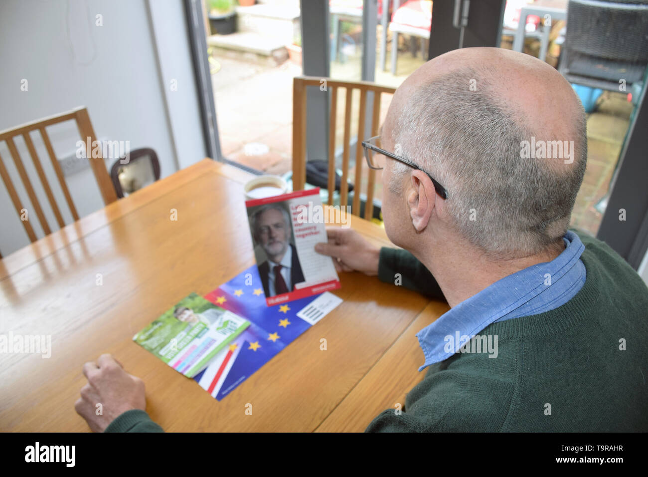 European Parliament Elections May 2019 - man reading various Labour Party political party leaflet. UK May 2019 - Stock Image