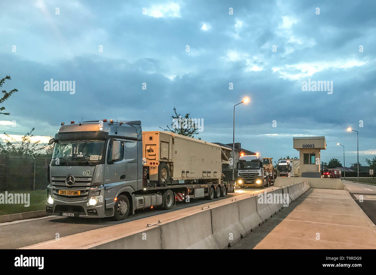 MIHAIL KOGALNICEANU (MK) AIR BASE, ROMANIA – A convoy of Romanian trucks carrying a Terminal High Altitude Area Defense (THAAD) interceptor system leave Mihail Kogalniceanu (MK) Air Base, Romania, in route to Naval Support Facility Deveselu, Romania May 10. The 400-kilometer convoy was the longest the THAAD system has traveled on road outside of the continental U.S. The deployment of the THAAD is in support of the NATO Ballistic Missile Defense mission and reinforces the strong and unremitting U.S. commitment to the defense of our NATO allies. (Photo by U.S. Army Master Sgt. James Redd, 174th  - Stock Image