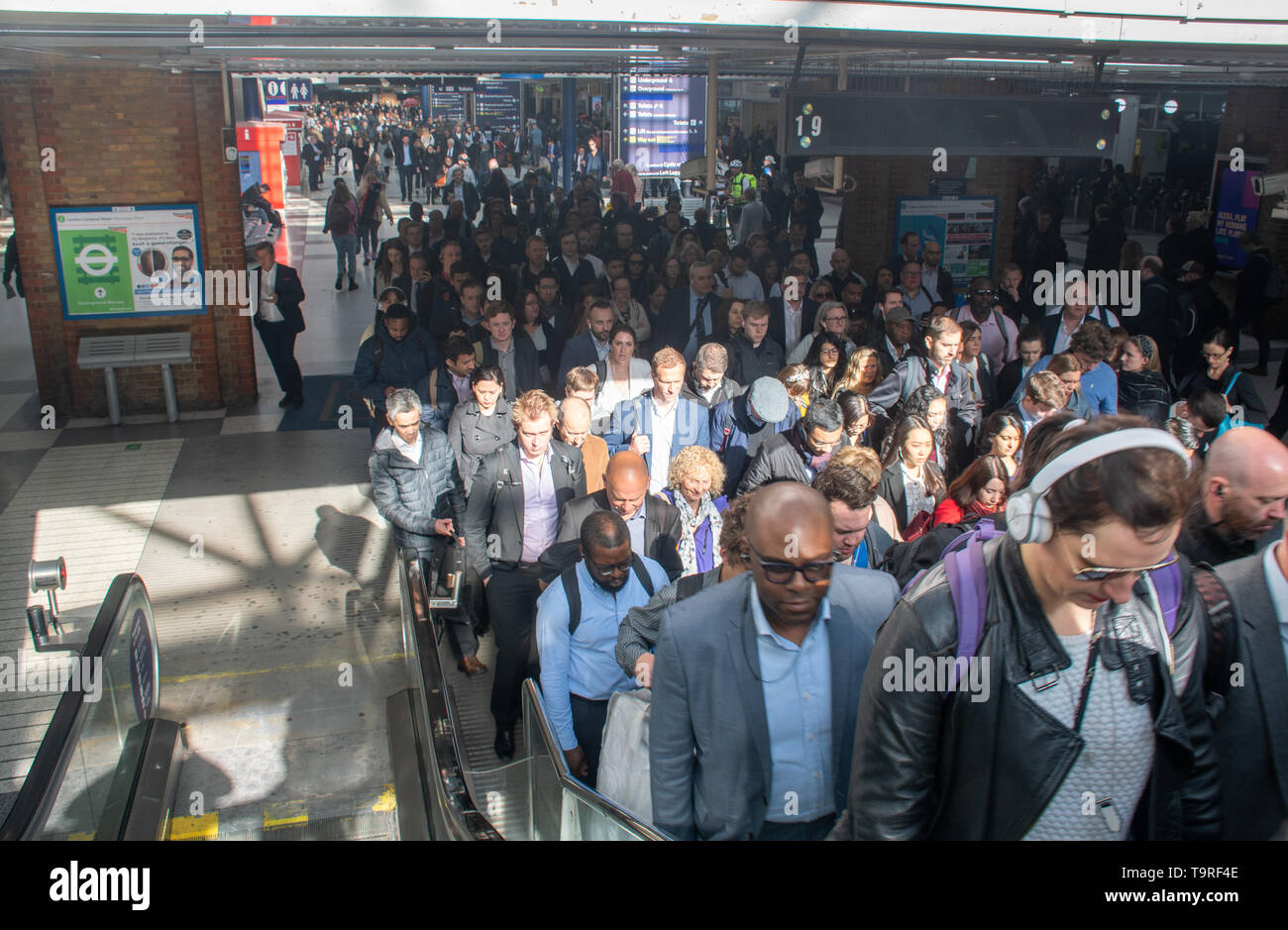 London Liverpool Street United Kingdom  -13 May 2019: Crowd of commuters queuing to leave rail Terminal via stairs - Stock Image