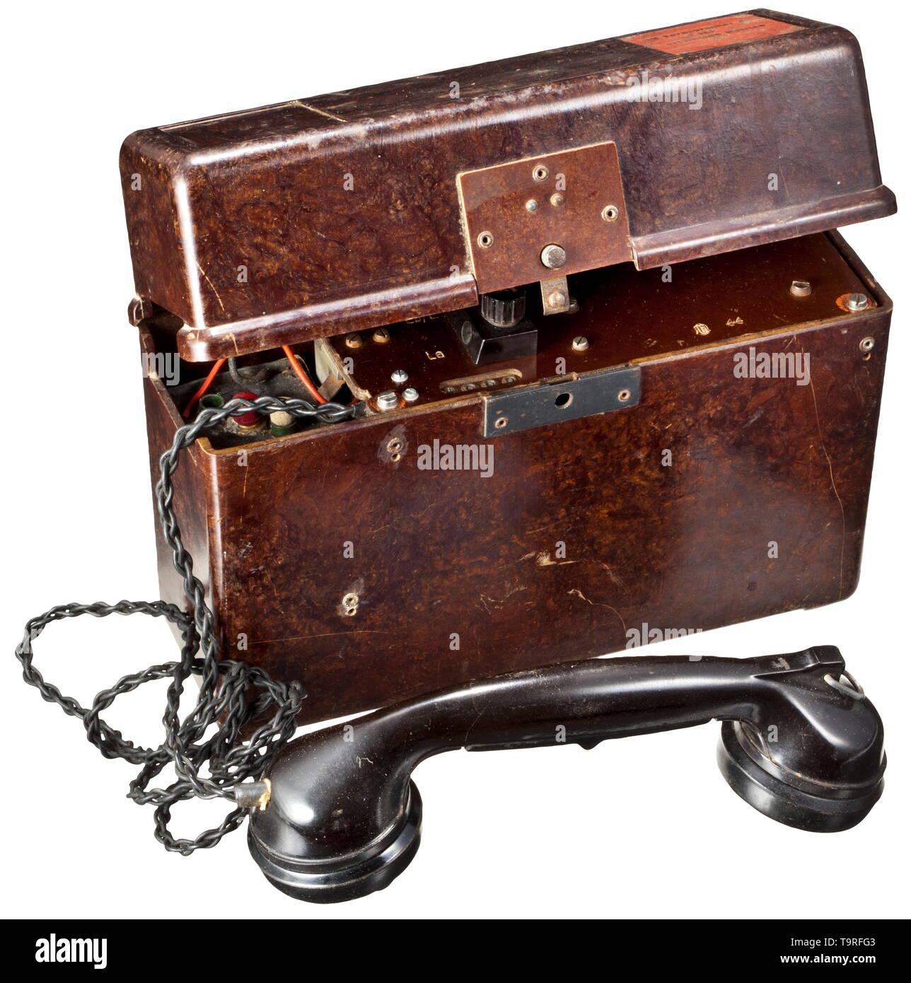 A stationary battery OB (Ortsbatterie) for communications unit 43 (non-portable) Braunes Bakelitgehäuse mit rotem Typenschild, Einsatz mit Stempelung von 1944, komplett mit Hörer, den beiden Rändelschrauben für die Anschlüsse und dazugehöriger(?) Batterie. Kurbel fehlt. Vollständigkeit und Funktion nicht überprüft. historic, historical, 20th century, Editorial-Use-Only - Stock Image