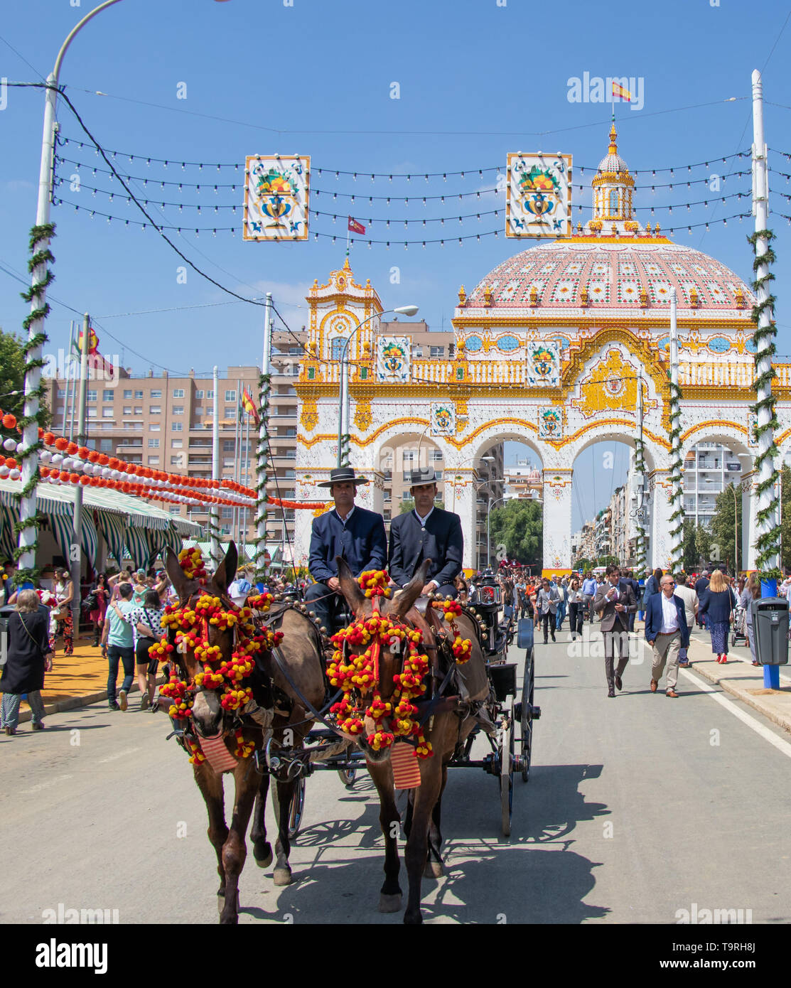 Seville, Spain - May 5, 2019: Horse drawn carriage during the April Fair of Seville on May, 5, 2019 in Seville, Spain - Stock Image