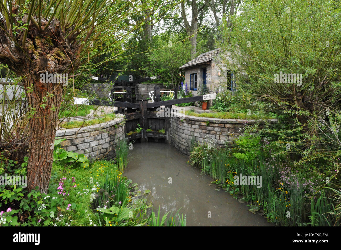 The Welcome to Yorkshire Garden (designed by Mark Gregory), one of the eleven beautiful and elegant show gardens on display at the 2019 RHS Chelsea Flower Show which opened today in the 11-acre grounds of the Royal Hospital Chelsea, London, United Kingdom - 20 May 2019  The garden is inspired by the rich heritage and history of infrastructure in West Yorkshire, reminiscent of the urban regeneration of the likes of the Huddersfield Narrow Canal, now a major tourist attraction.  There are 26 themed gardens on display at this year's show as well as over 100 plant displays in the Great Pavilion. N - Stock Image