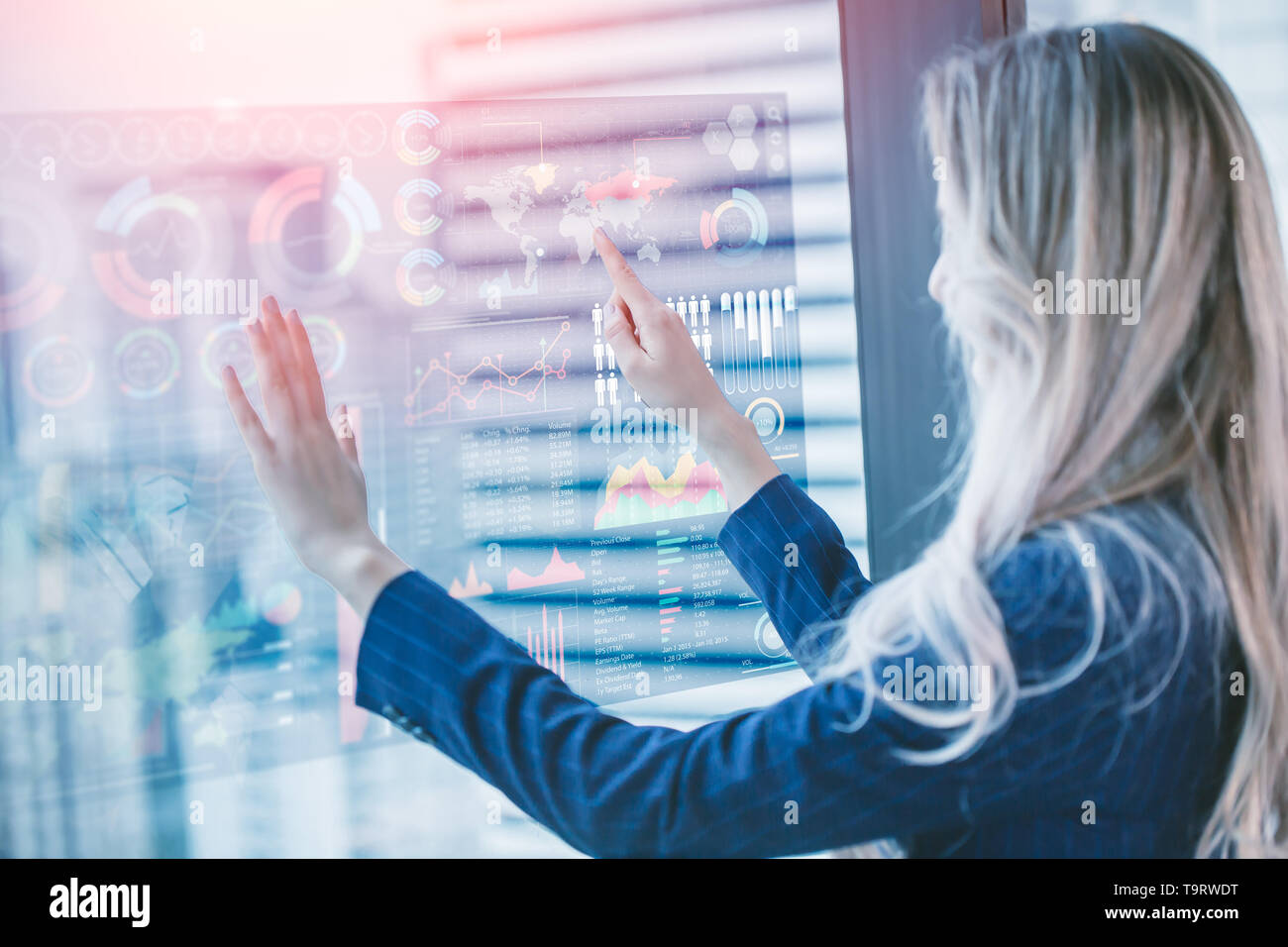 Future of Business Concept, Image of businesswoman touching hologram screen mix media information chart overlay city background Stock Photo