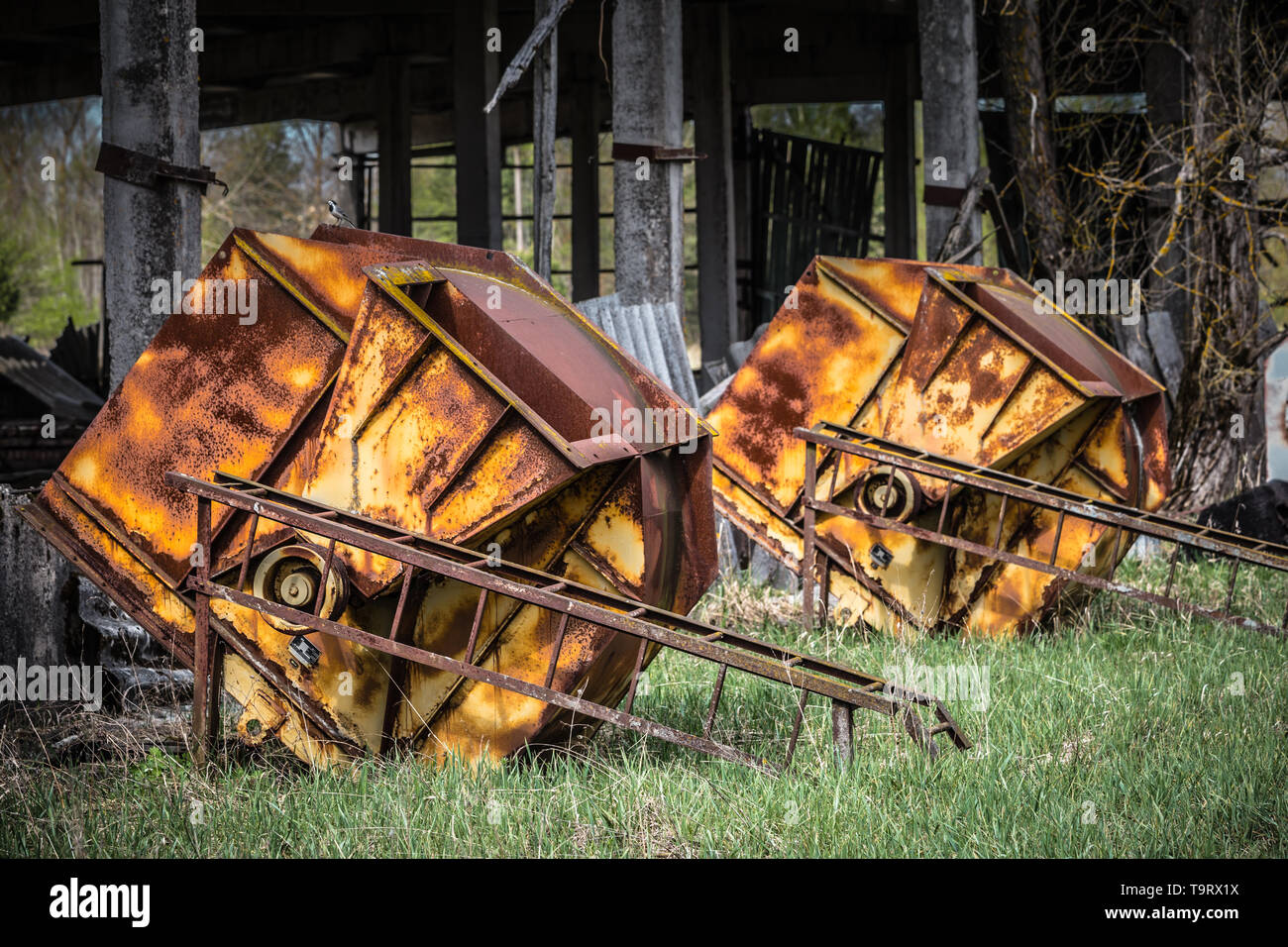 Rusted feed silos in an abandoned farm in Belarus Chernobyl exclusion zone, - Stock Image