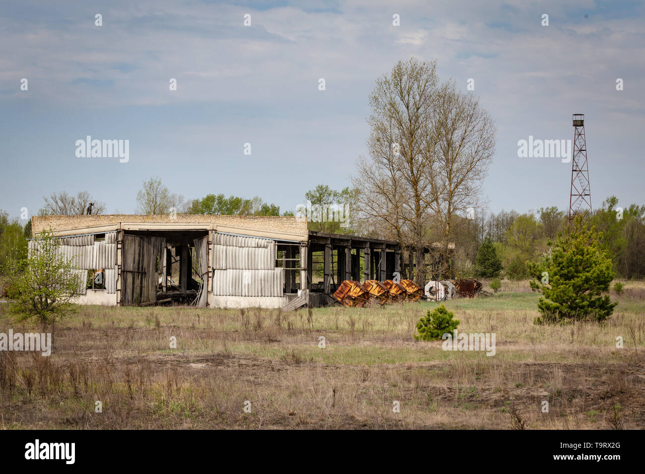 Collapsed farm stable and watchtower in Belarus Chernobyl exclusion zone, - Stock Image