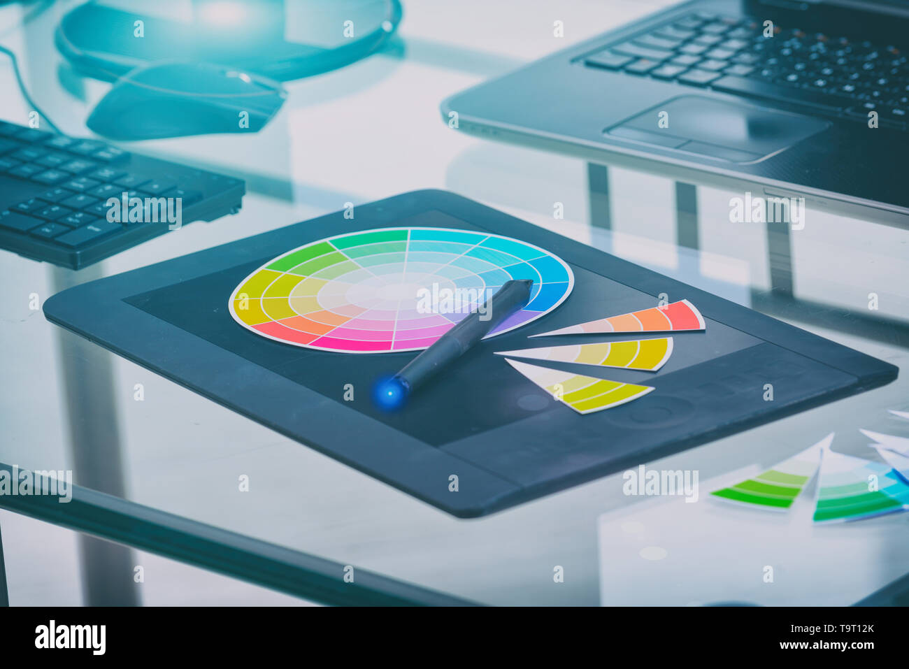 Designer tools used in office graphics tablet color wheel and computers Stock Photo