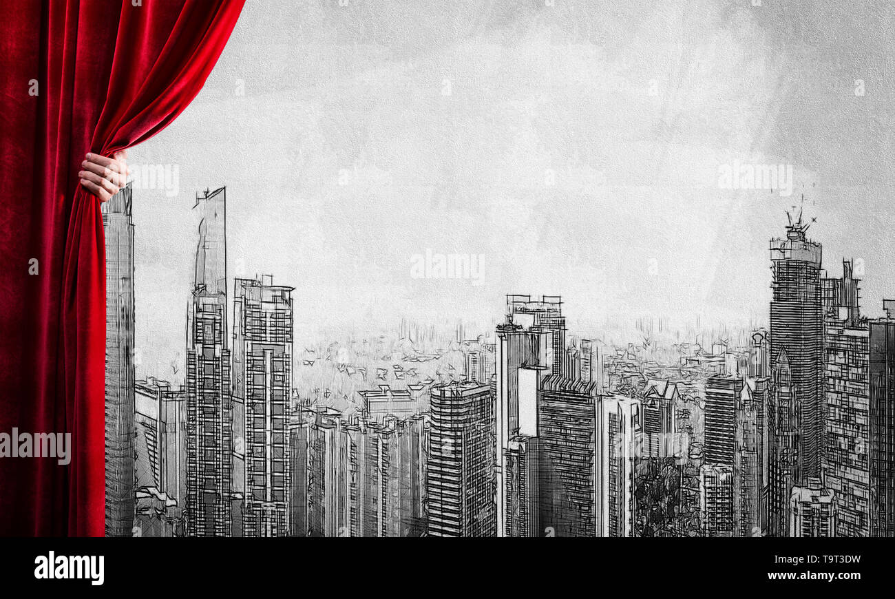 Drawn modern cityscape behind drapery curtain and hand opening it - Stock Image