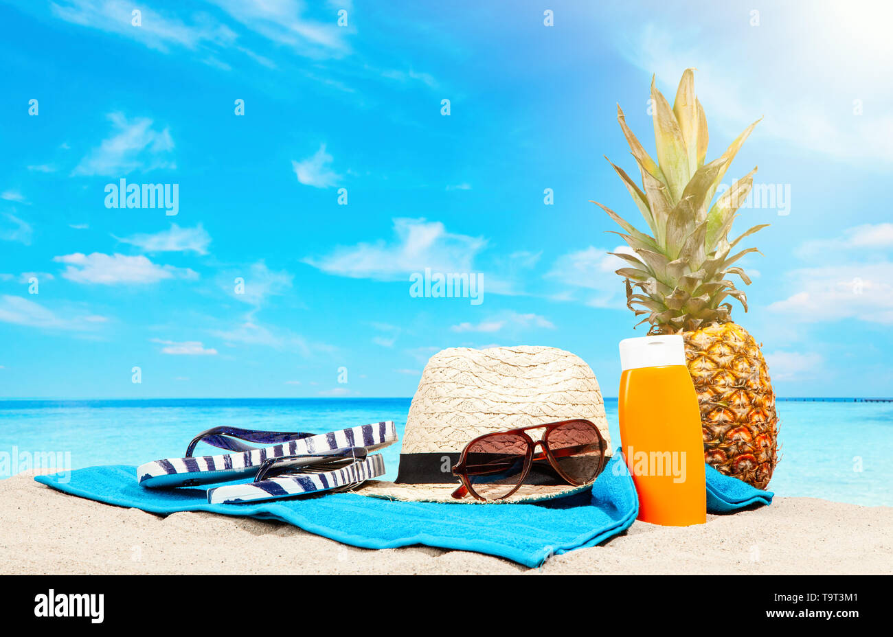 Beach accessories lying on sand - Stock Image