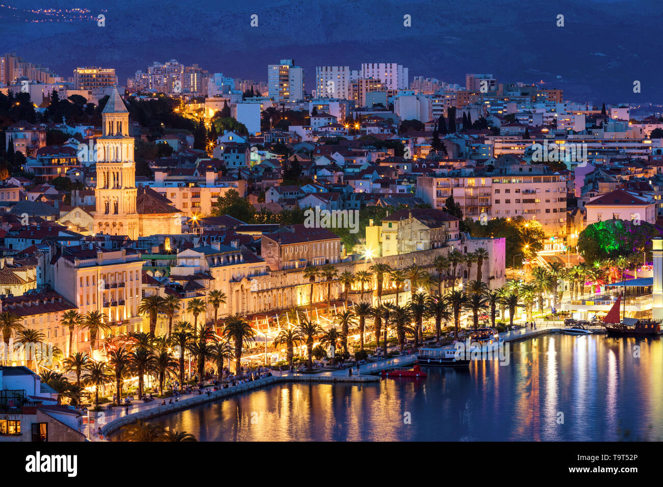 Amazing Split city waterfront panorama at blue hour, Dalmatia, Europe. Roman Palace of the Emperor Diocletian and tower of Saint Domnius cathedral. Sp - Stock Image