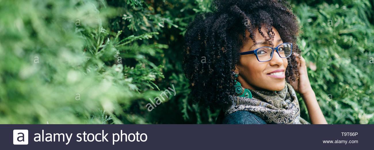 Beautiful black woman wearing eye glasses banner. Fashion and eyewear concept. - Stock Image