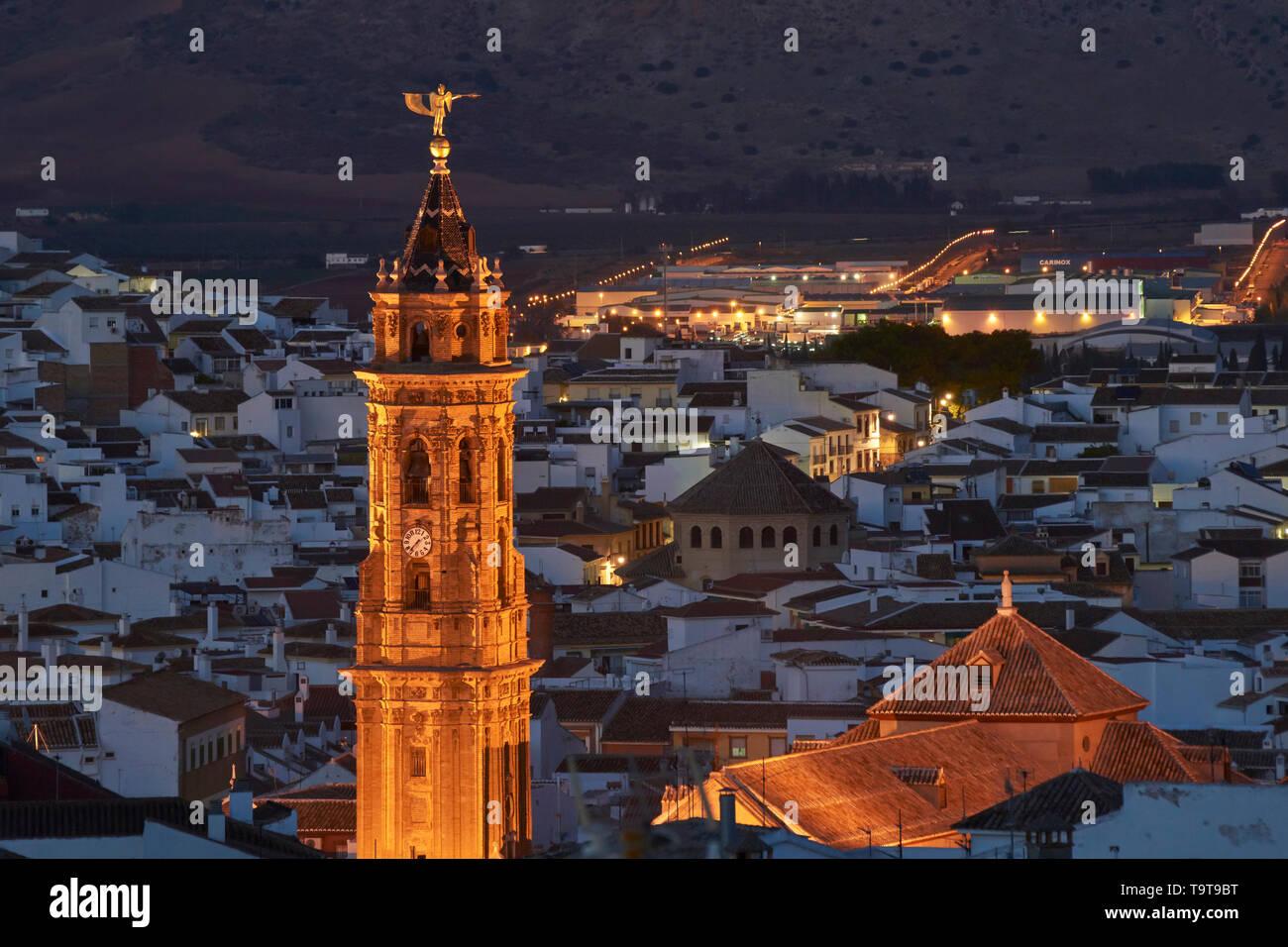 Antequera by Night, Málaga. World Heritage. Tower of San Sebastian church illuminated at night. - Stock Image