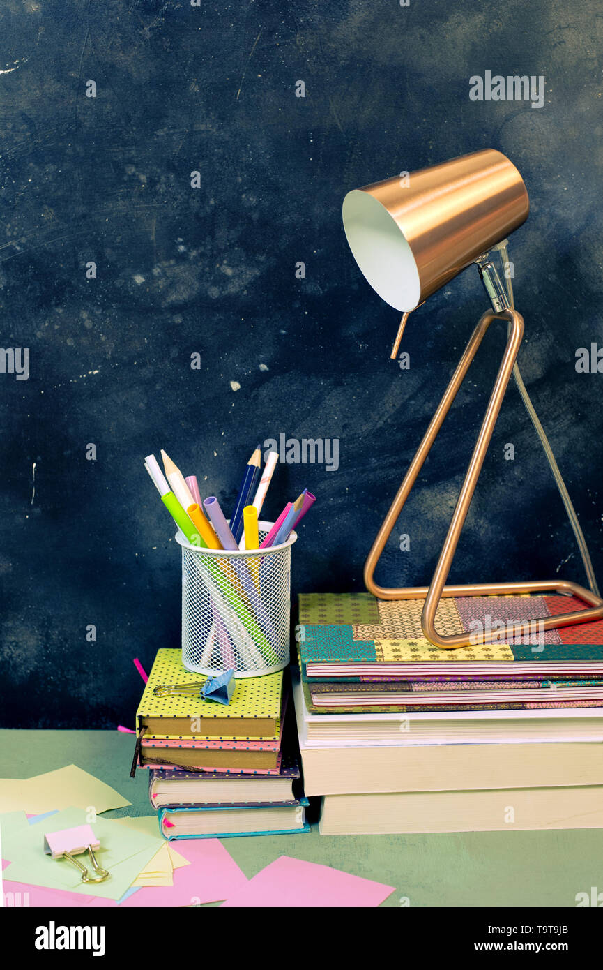 Back to school composition with vintage alarm clock and books - Stock Image