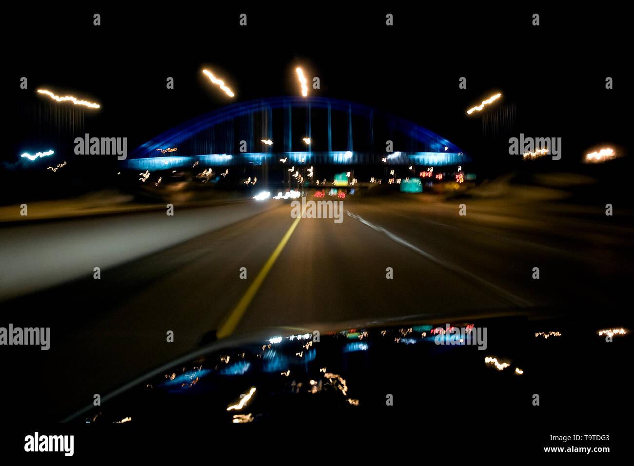 Motion blur image of I-235 bridge at night, Des Moines, Iowa - Stock Image