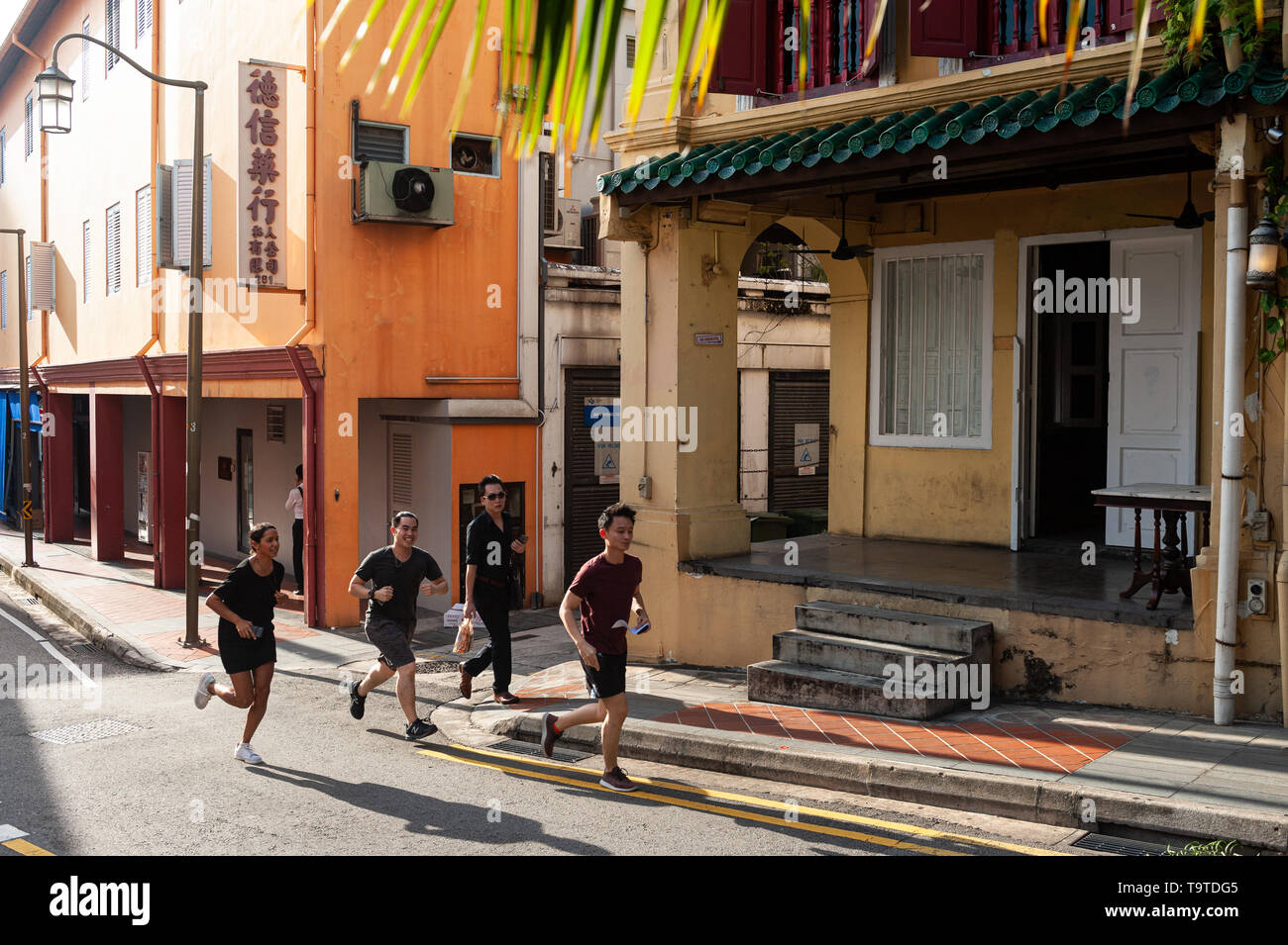 09.05.2019, Singapore, Republic of Singapore, Asia - People are seen walking along a street in Chinatown. - Stock Image