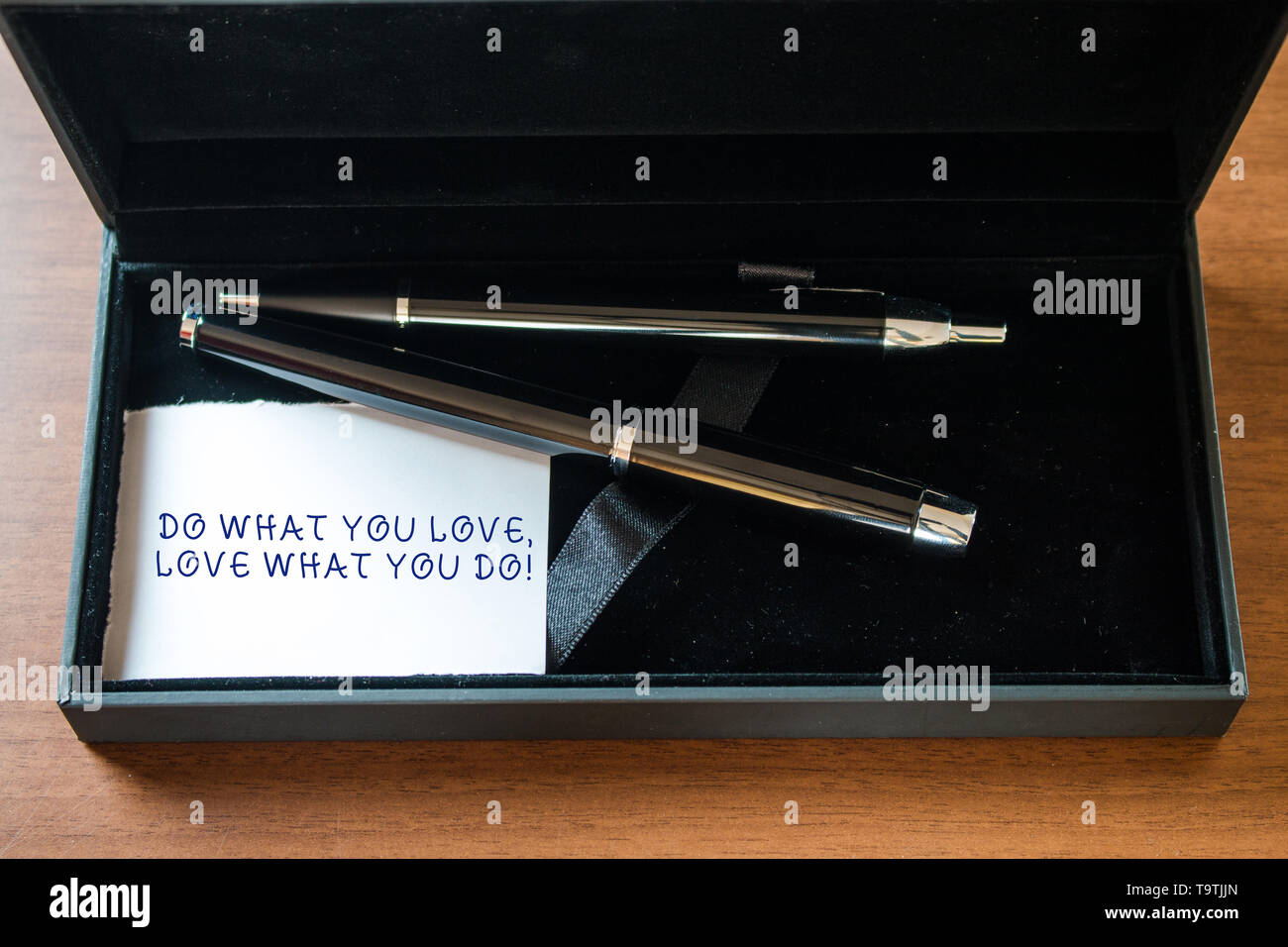 Writing note showing Do What You Love Love What You Do. Business concept for you able doing stuff you enjoy it to work in better places then Close up  - Stock Image