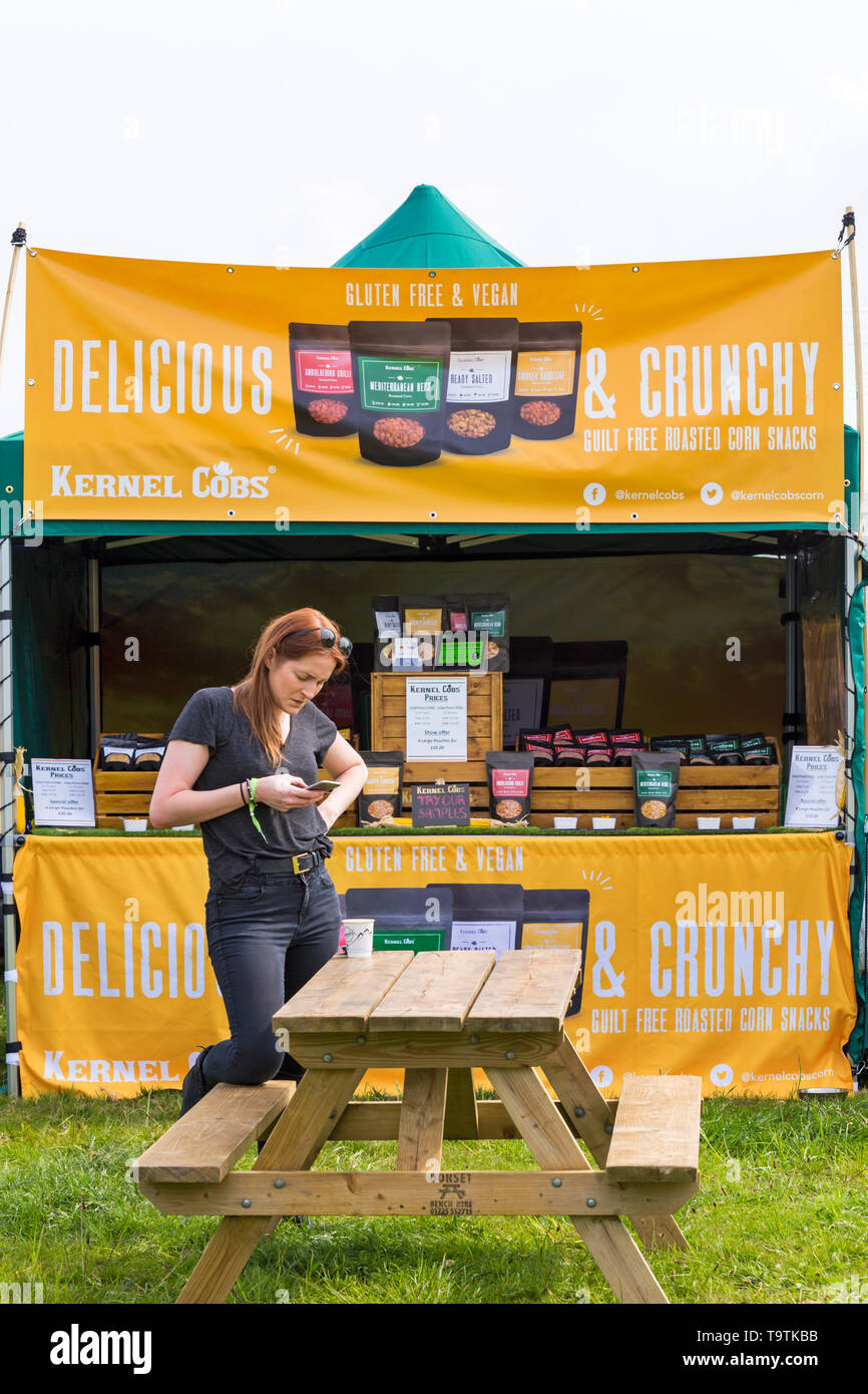 Kernel Cobs delicious & crunchy guilt free roasted corn snacks, gluten free & vegan  at Dogstival, Pylewell Park Estate, Lymington, UK in May - Stock Image