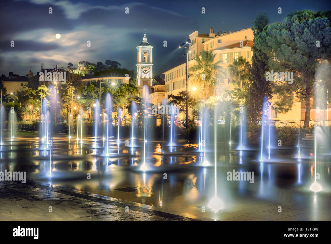 Night view of fountain on Place Massena at downtown Nice. French Riviera, France Stock Photo