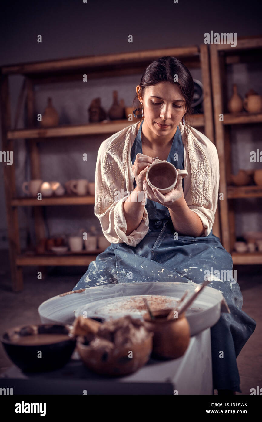 Beautiful craftsman at his wheel creating a new masterpiece. The concept of craft creativity. - Stock Image