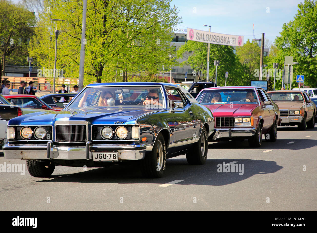 Salo, Finland. May 18, 2019. Classic cars driving along street to participate in the gathering of Salon Maisema Cruising 2019. Stock Photo