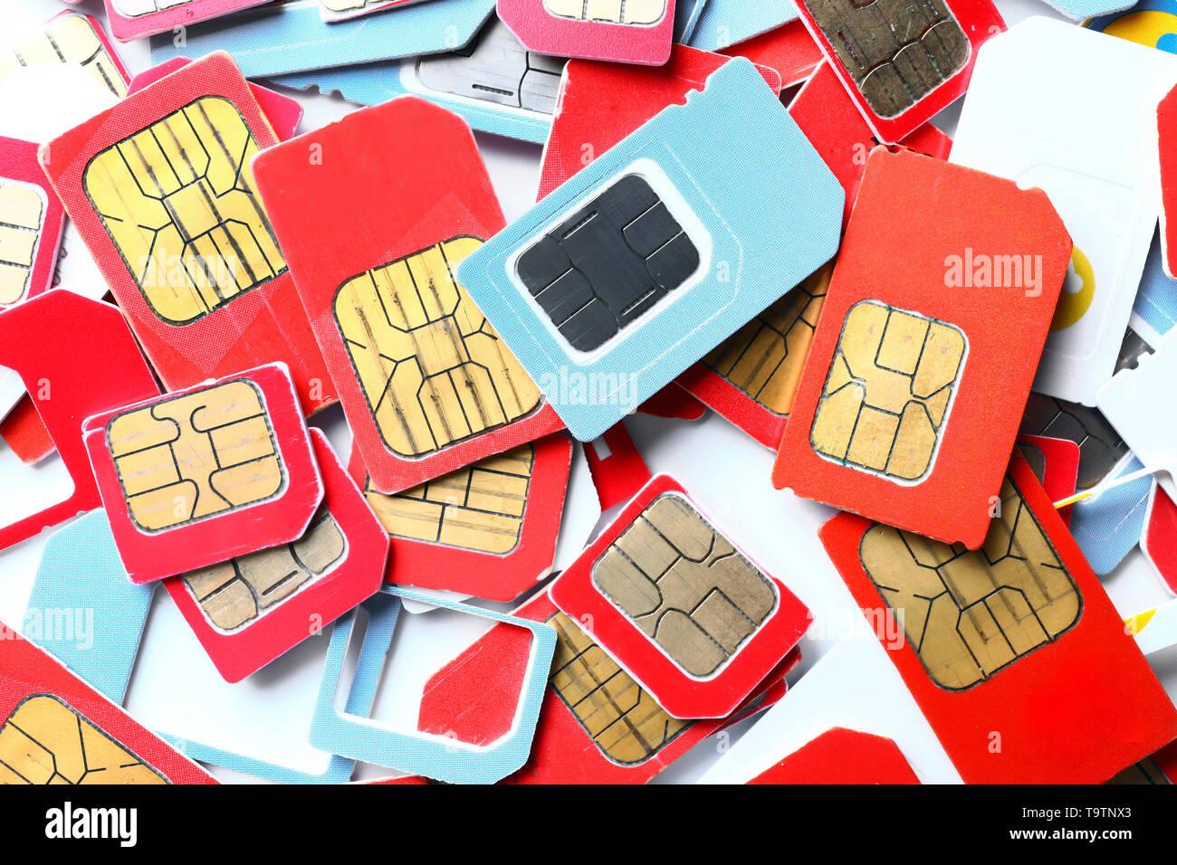 Many sim cards on white background - Stock Image