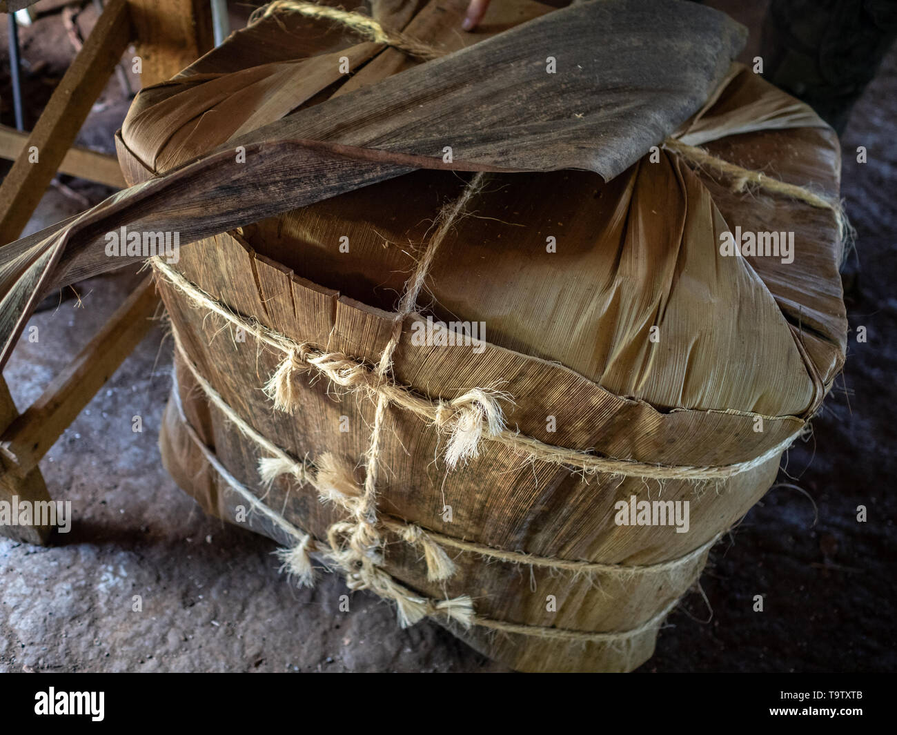 Vinales tobacco country, a block of tobacco leaves wrapped up with string ready to be shipped - Stock Image