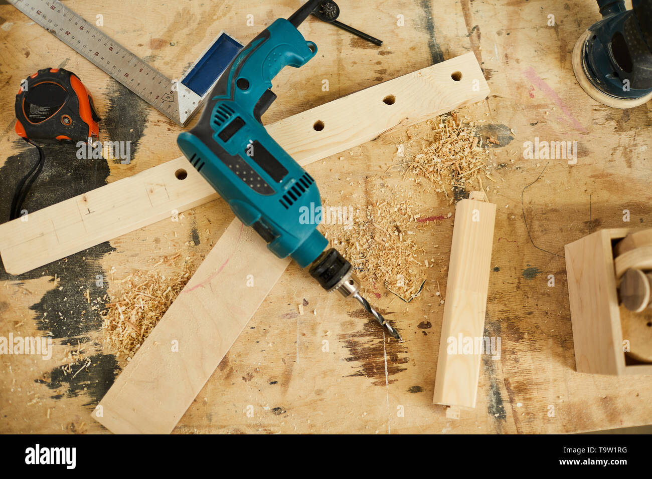 Above view background of tools and wood lying on table in carpenters workshop, copy space - Stock Image