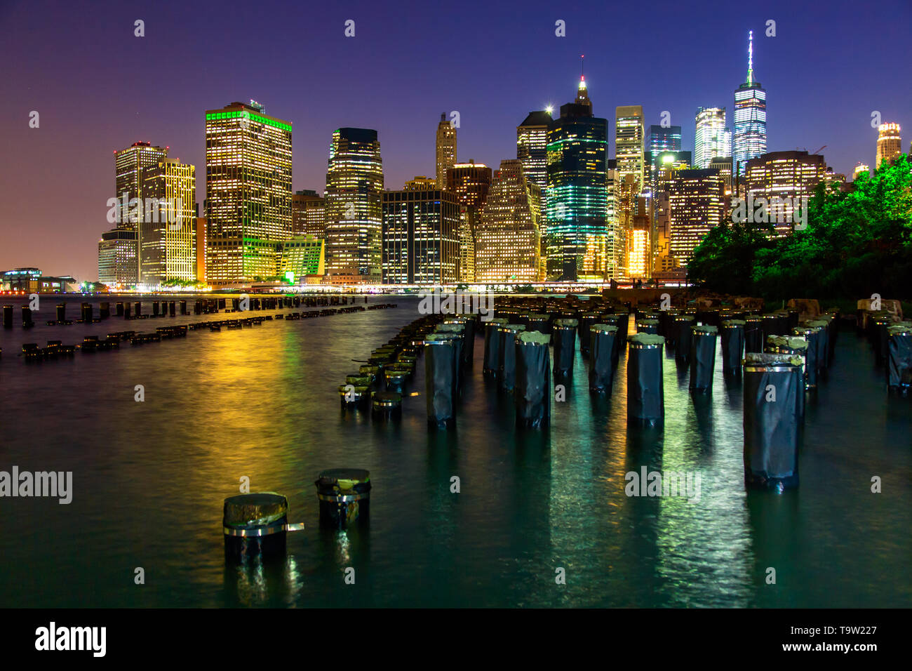 Manhattan at dusk viewed from the Brooklyn Bridge Park in New York City - Stock Image