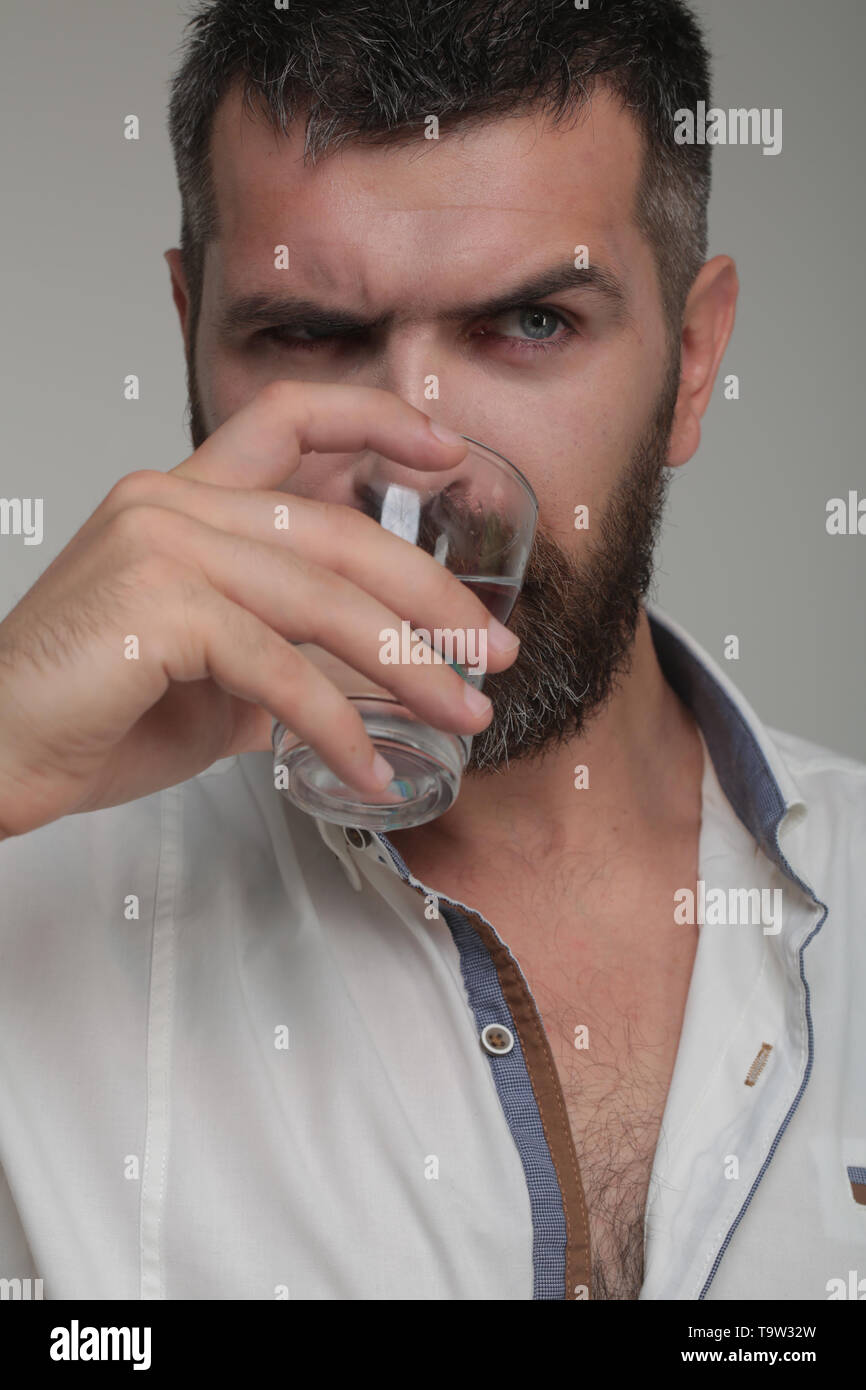 Bearded hipster drink water - Stock Image
