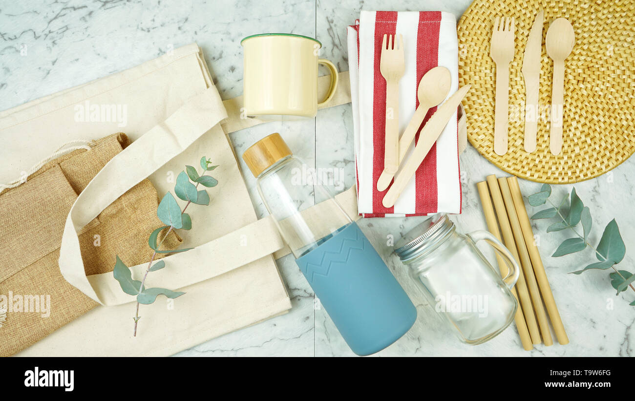 Zero-waste, plastic-free tableware flatlay overhead with bamboo and natural fibers to replace single use plastic products. - Stock Image