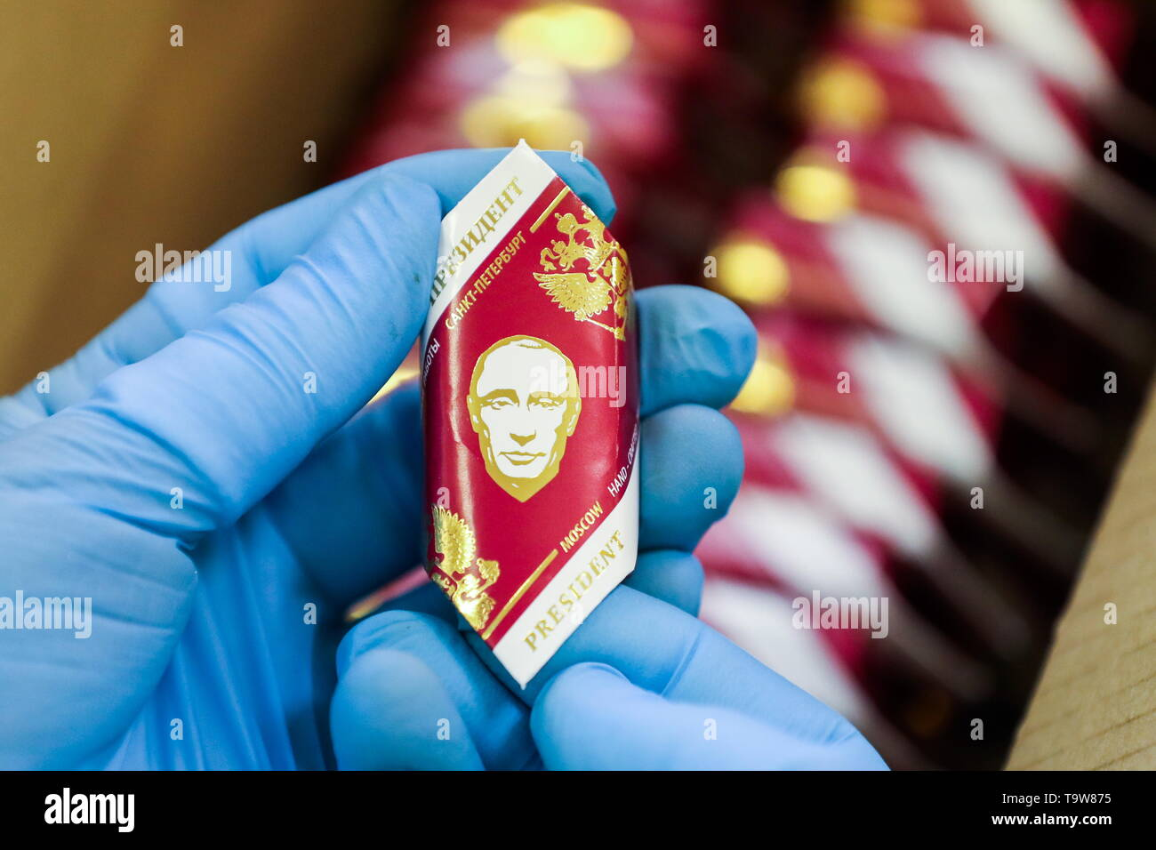 St Petersburg, Russia. 20th May, 2019. ST PETERSBURG, RUSSIA - MAY 20, 2019: A sweet wrapper bearing an image of Russian President Vladimir Putin produced at the GC - Golden Candies factory. Peter Kovalev/TASS Credit: ITAR-TASS News Agency/Alamy Live News Stock Photo