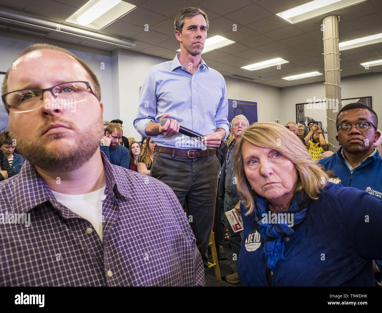 Davenport, Iowa, USA. 20th May, 2019. BETO O'ROURKE, (center) a Texas Democrat, listens to a question from an attendee during a town hall style campaign appearance in Davenport. About 200 people came to the event in the River Music Experience, a downtown venue. O'Rourke, running to be the 2020 Democratic nominee for the US Presidency, has made climate change a central part of his campaign. He held a town hall in Davenport Monday. Iowa traditionally hosts the the first election event of the presidential election cycle. The Iowa Caucuses will be on Feb. 3, 2020. (Credit Image: © Jack Kurtz/ZUMA - Stock Image
