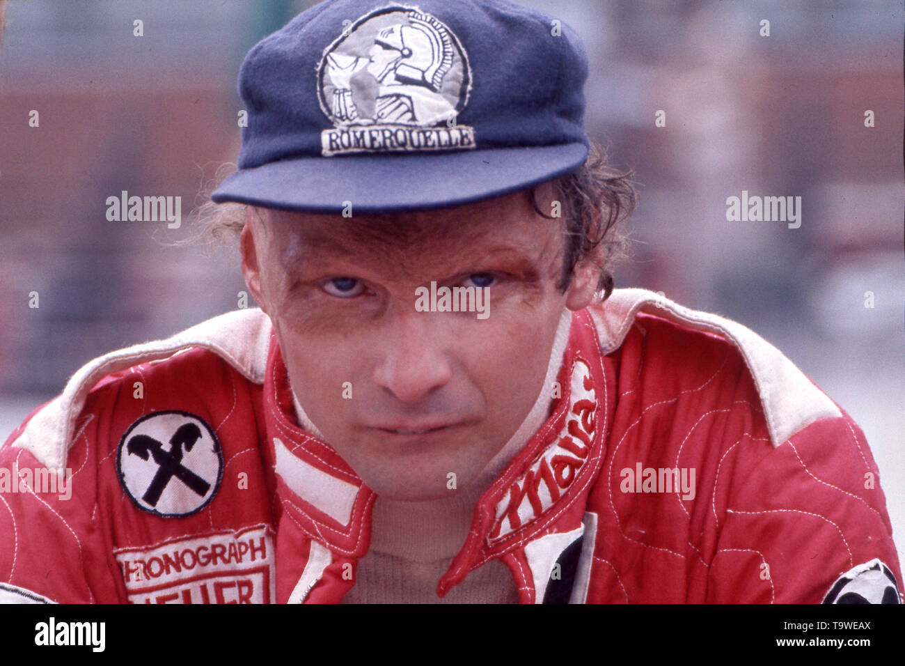 Hockenheim, Deutschland. 21st May, 2019. Niki Lauda died at the age of 70 Niki LAUDA (AUT), Formula One, racing driver, Scuderia Ferrari, portrait, with cap (MvO), Kaeppi (KvOUU), in racing suit, during a break, grim look, serious, bad-tempered; not exactly dated color photograph from the year 1977; vǬ | usage worldwide Credit: dpa/Alamy Live News - Stock Image