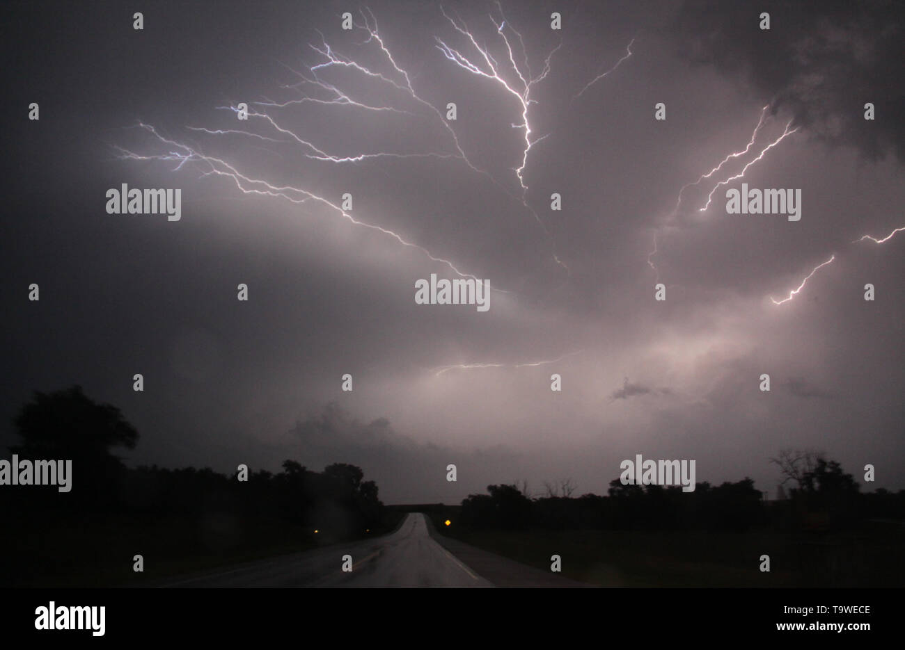 Lightning strikes at night from huge squall line covering 6 states areas in the Oklahoma City as flooding rain and severe storms, including tornadoes, are predicted in the Southern Plains through late Monday May 20, 2019. Tornado watches in effect in the Texas Panhandle and Oklahoma expire before midnight. Then, flooding is expected to become the major concern overnight from Oklahoma City to Tulsa and to the northeast. The tornado outbreak has not been as severe as feared as twisters have mostly avoided population centers. Photo by Gene Blevins/ZumaPress (Credit Image: © Gene Blevins/ - Stock Image