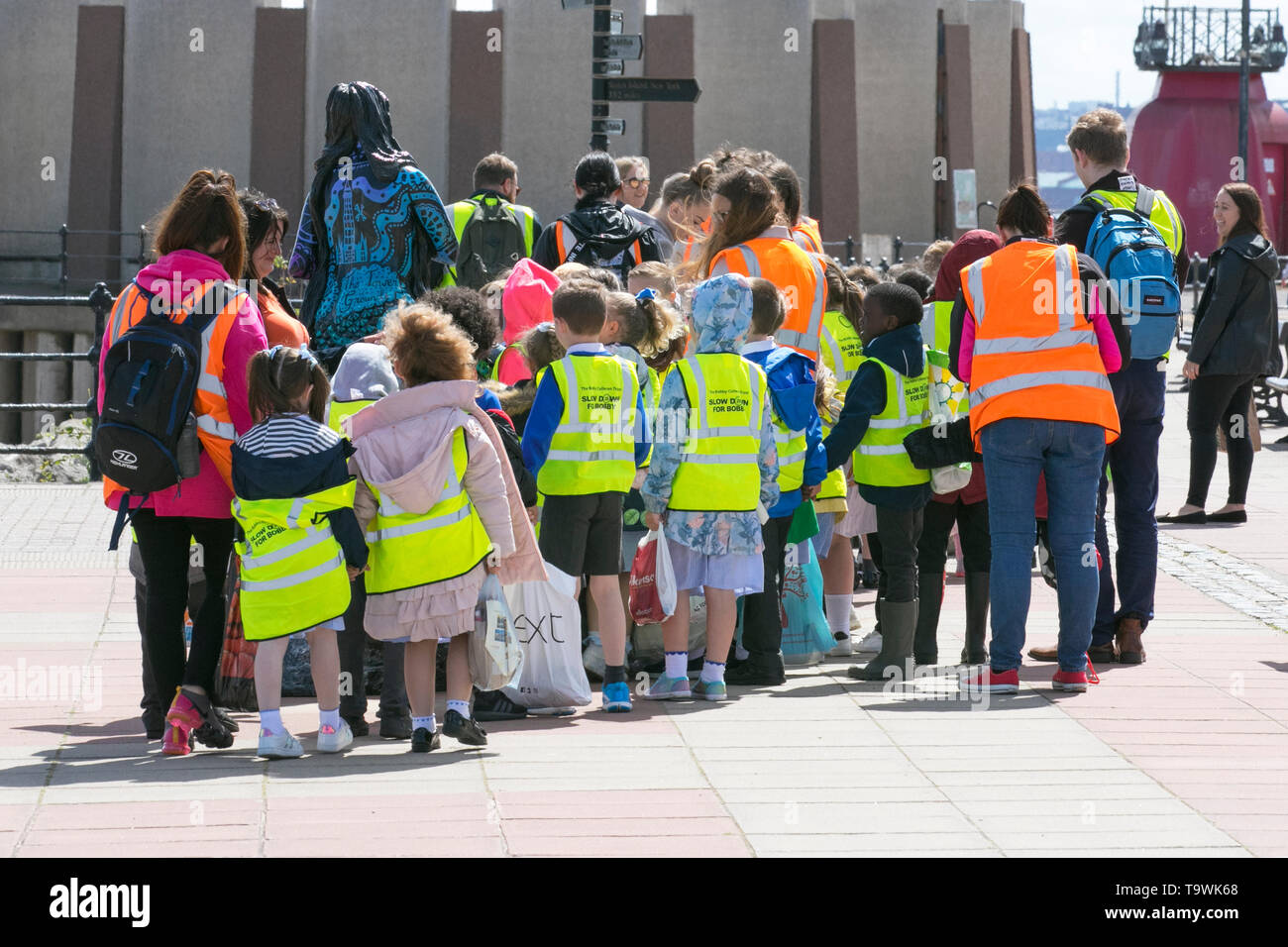 New Brighton, Wallasey. 21st May, 2019. UK Weather: Bright and sunny on the wirral riverside as pre-school children enjoy an escorted walk on the seafront promenade. Each child wearing a hi-vis tabard printed 'Slow down for Bobby' Twenty's Plenty; The Bobby Colleran Trust is Road Safety Charity offering advice and guidance for Parents and Schools. Since Bobby's accident, his family have campaigned for safer roads outside all schools. Credit; MediaWorldImages/AlamyLiveNews. - Stock Image