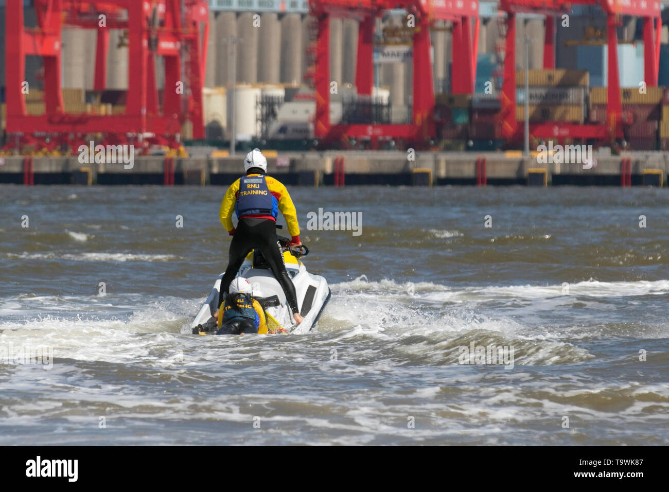 New Brighton, Wallasey. 21st May, 2019. UK Weather: Bright and sunny on the wirral riverside. RNLI Jetski training & rescue on the River Mersey using Yamaha craft. The exercise was a simulation of the lifeboat recovering a casualty from a high speed Jet Ski accident with the casualty being initially treated on the afloat lifeboat then the transfer of care to the shore based teams. Credit: MediaWorldImages/Alamy Live News - Stock Image
