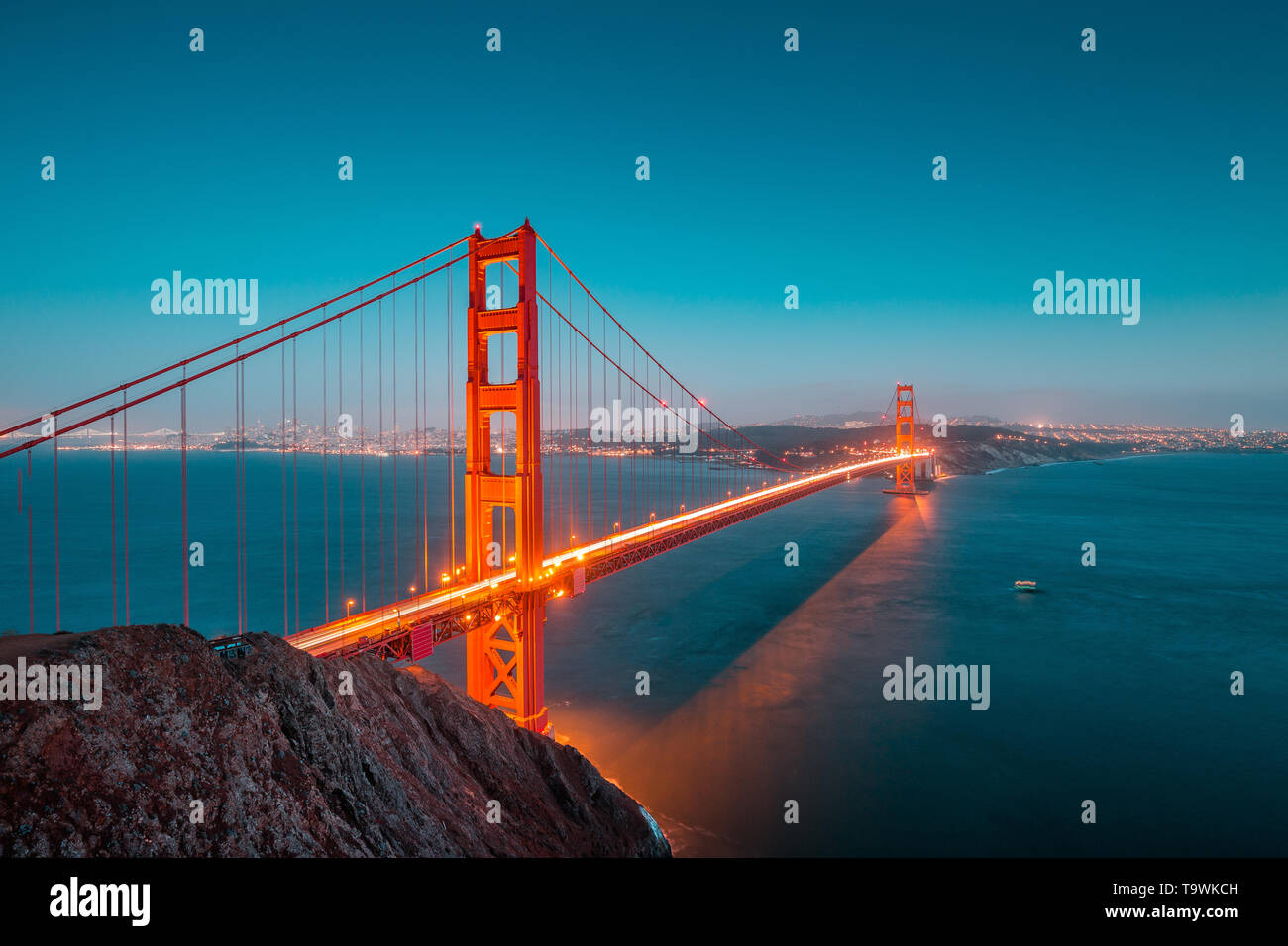 Classic panoramic view of famous Golden Gate Bridge seen from Battery Spencer viewpoint in beautiful post sunset twilight during blue hour at dusk in  - Stock Image
