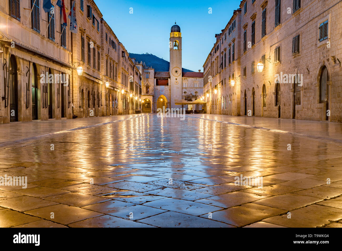 Classic panoramic view of famous Stradun, the main street of the old town of Dubrovnik, in beautiful morning twilight before sunrise at dawn in summer - Stock Image