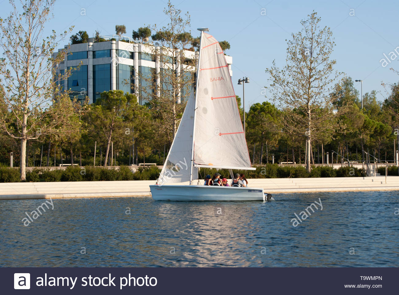 ATHENS, GREECE - AUGUST 2018- Kids enjoying sailing in city park canal - Stock Image