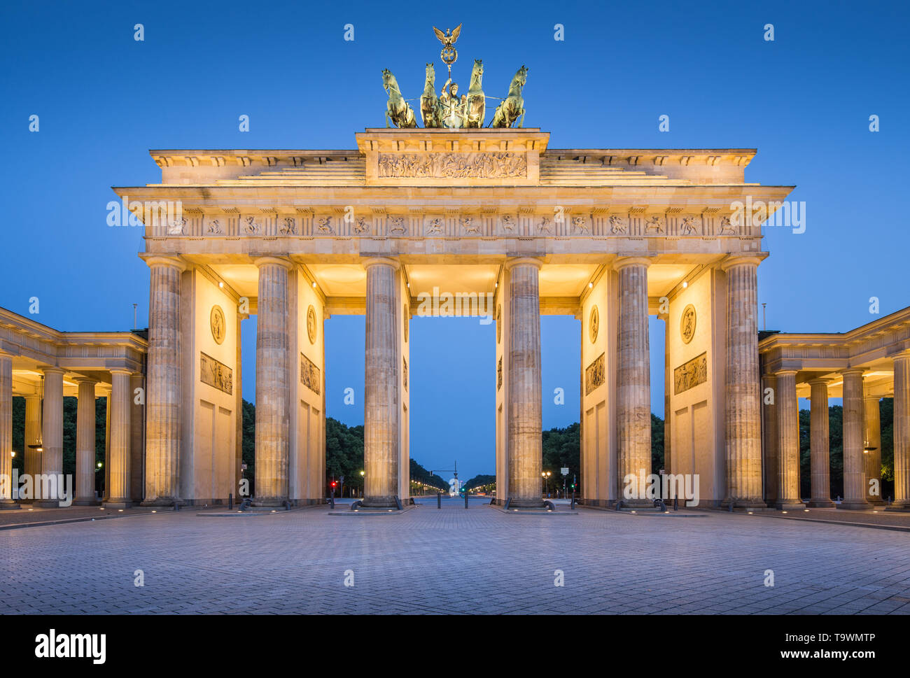 Panoramic view of famous Brandenburger Tor (Brandenburg Gate), one of the best-known landmarks and national symbols of Germany, in twilight during blu - Stock Image