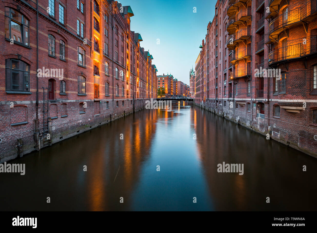 Classic view of famous Hamburg Speicherstadt warehouse district, a UNESCO World Heritage Site since 2015, illuminated in beautiful twilight - Stock Image