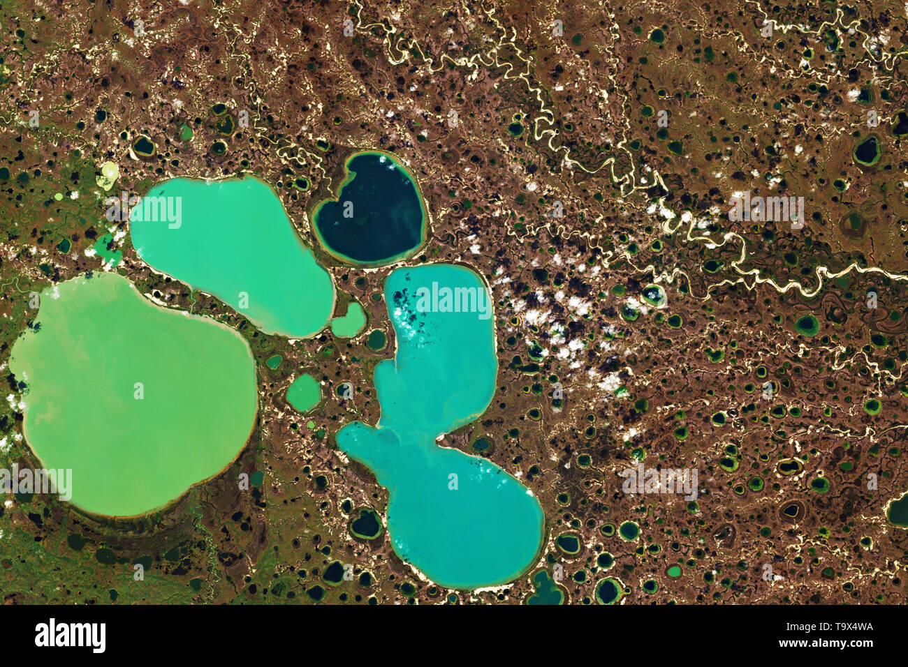 Ponds in the Yamal Peninsula in Northwest Siberia seen from space - contains modified Copernicus Sentinel Data (2018) - Stock Image