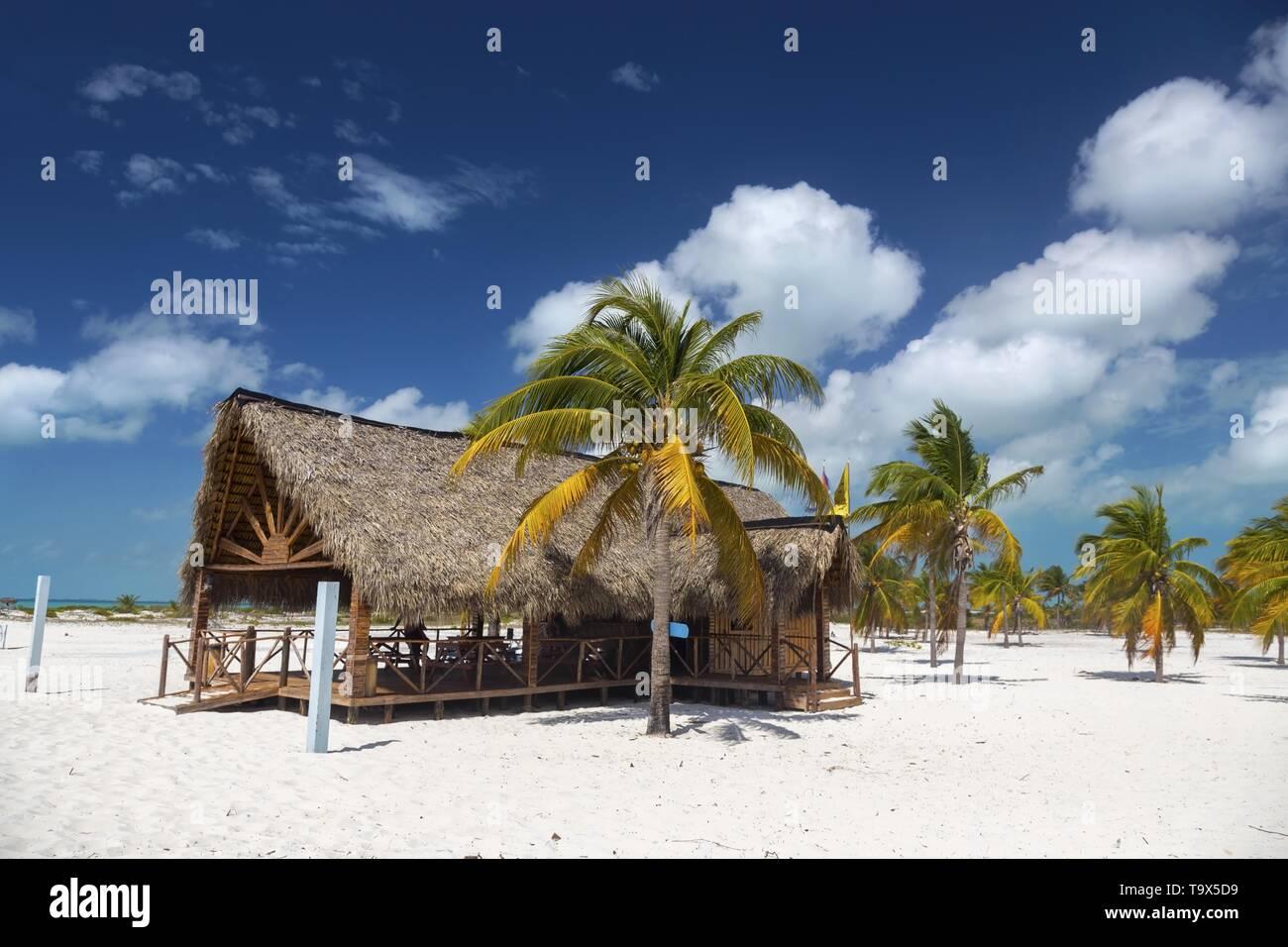 Beachfront Wooden Shack Bar and Grill Restaurant on Playa Sirena Tropical Beach on Cayo Largo Del Sur Tourist Resort Caribbean Sea Cuban Coast Stock Photo