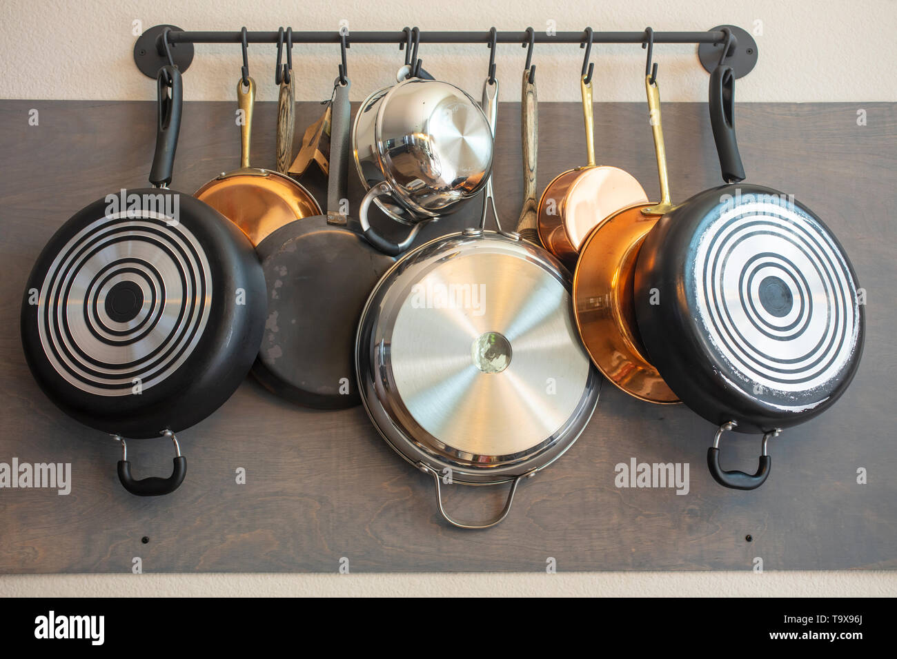 Kitchen Wall Rack For Hanging Pots Pans Aprons And Other Utensils For Efficient Organization Storage And Decor Stock Photo Alamy