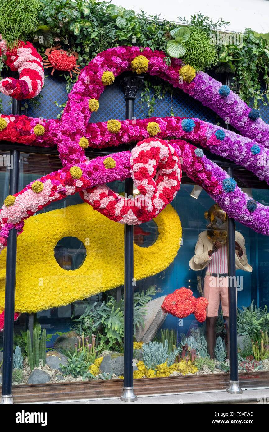 Floral display outside Hackett shop in Sloane Street for Chelsea in Bloom 2019. Chelsea, London, England - Stock Image
