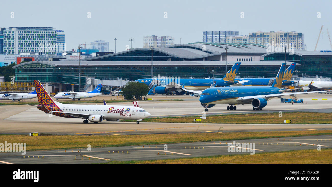 Saigon, Vietnam - Apr 23, 2019. Passenger airplanes taxiing on runway of Tan Son Nhat Airport (SGN). - Stock Image