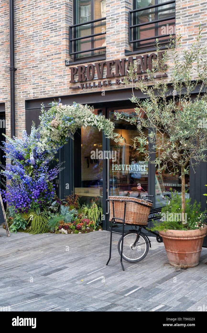 Floral display outside The Provenance village butcher shop in Pavilion Road for Chelsea in Bloom 2019. Chelsea, London, England - Stock Image