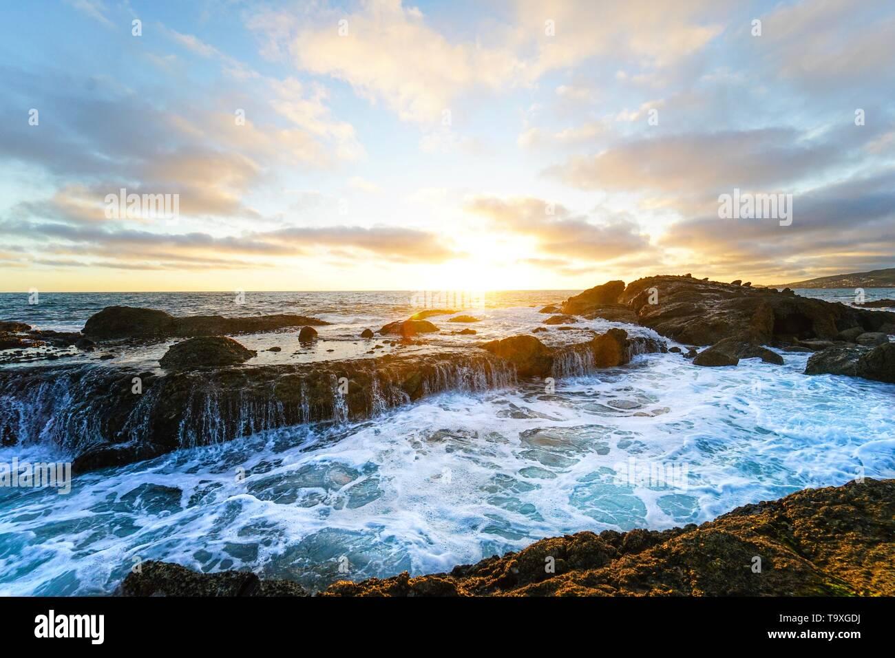 A beautiful sunset taken from a tidepool in Laguna Beach, California. - Stock Image