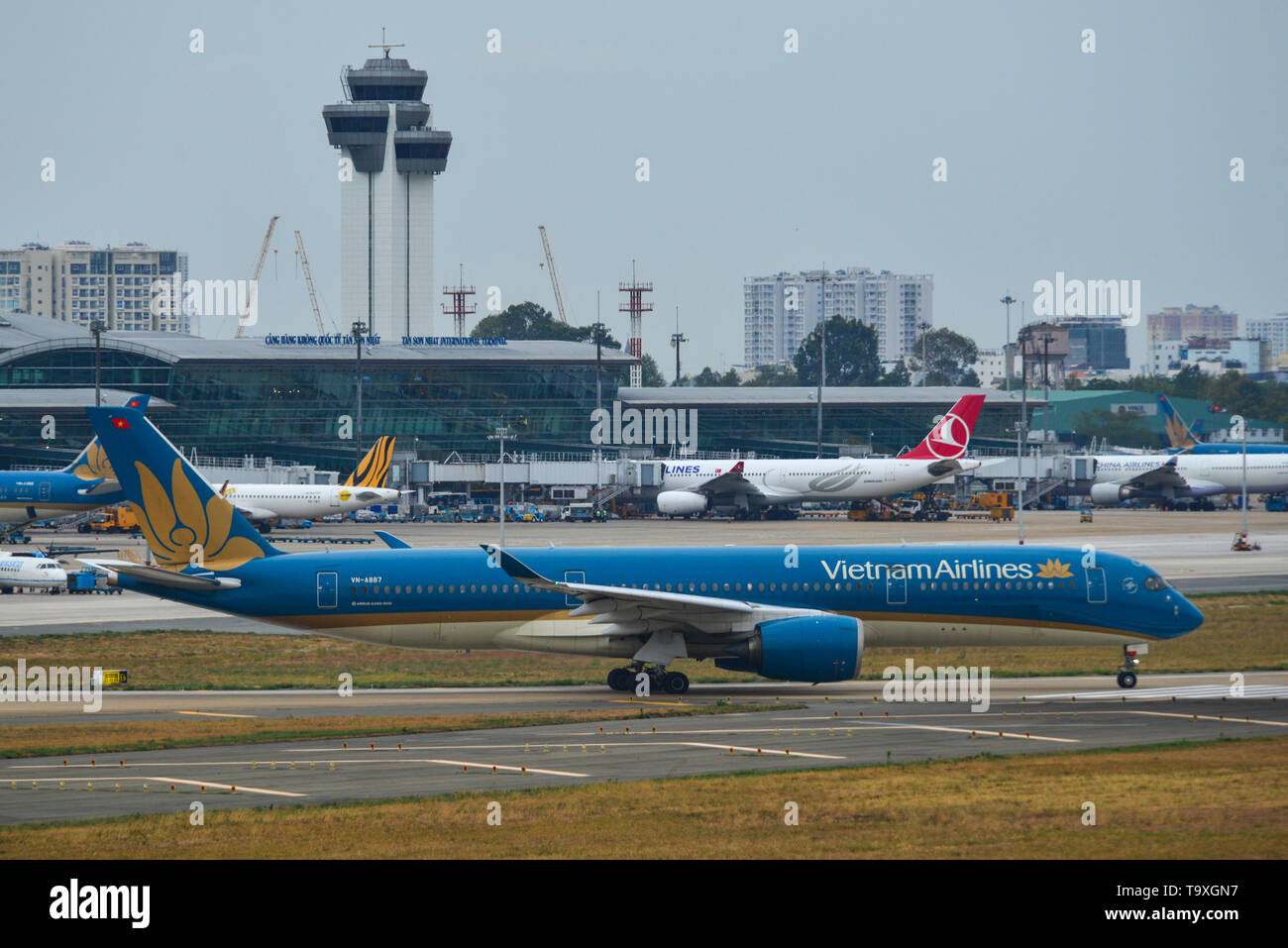 Saigon, Vietnam - Apr 23, 2019. VN-A887 Vietnam Airlines Airbus A350-900 taxiing on runway of Tan Son Nhat Airport (SGN). - Stock Image
